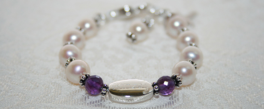Personalized christening bracelets.